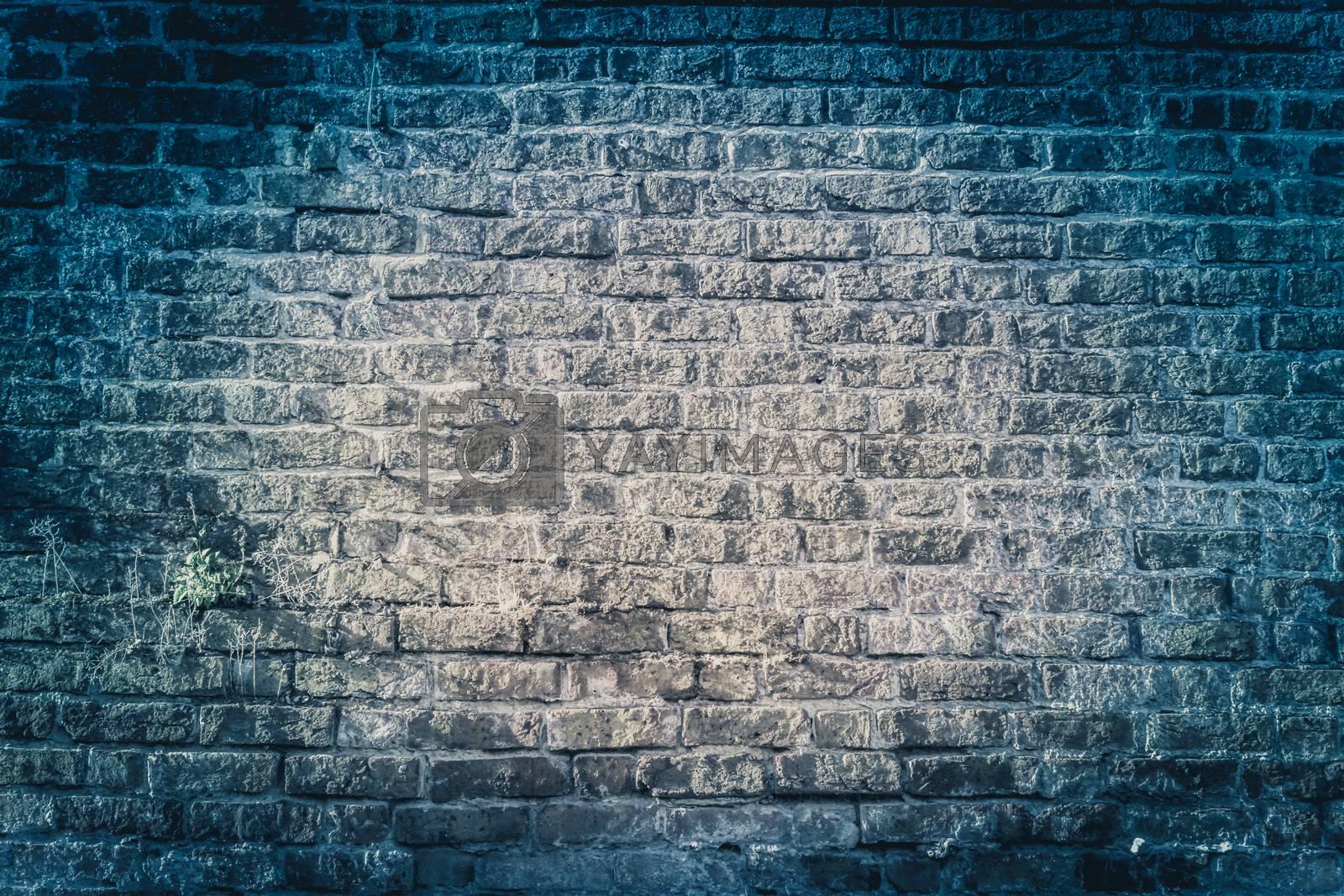 Dark blue grungy bricked wall textured background