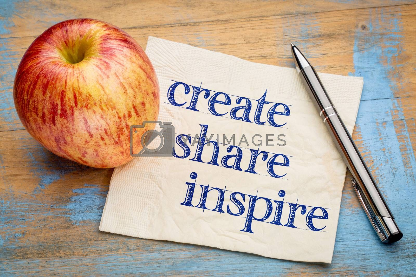 create, share inspire motivational words - handwriting on a napkin with a fresh apple