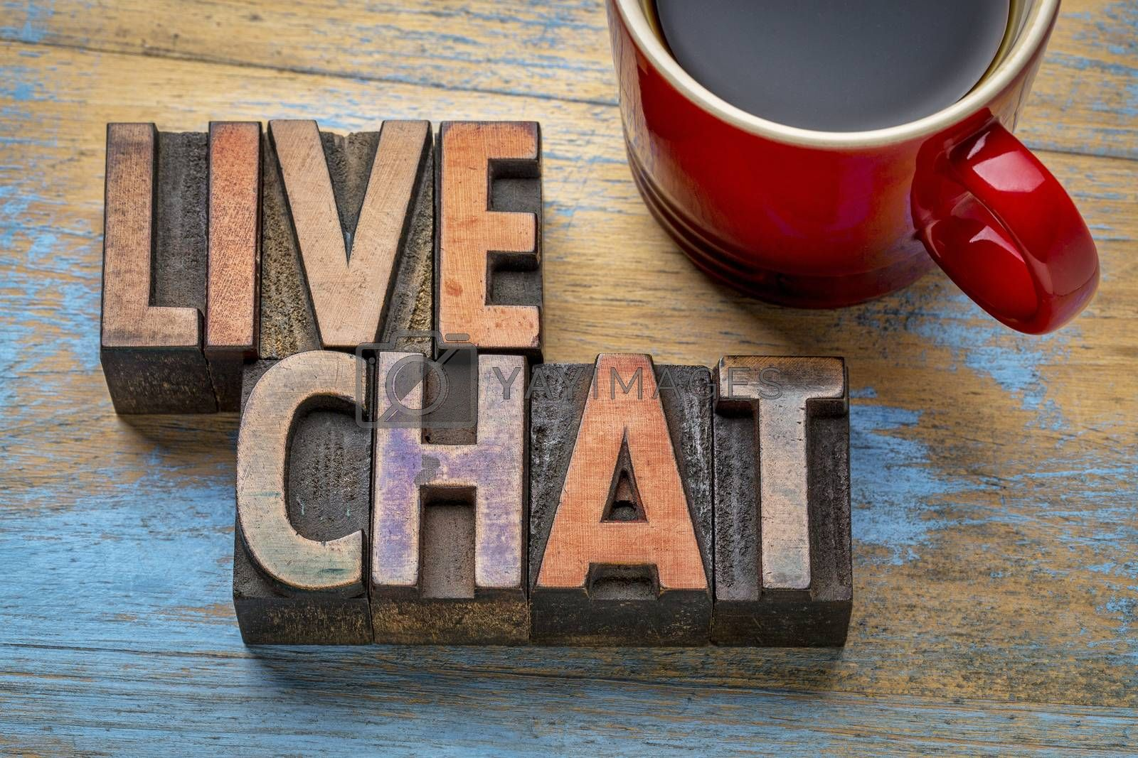 live chat word abstract in vintage letterpress wood type with a cup of coffee