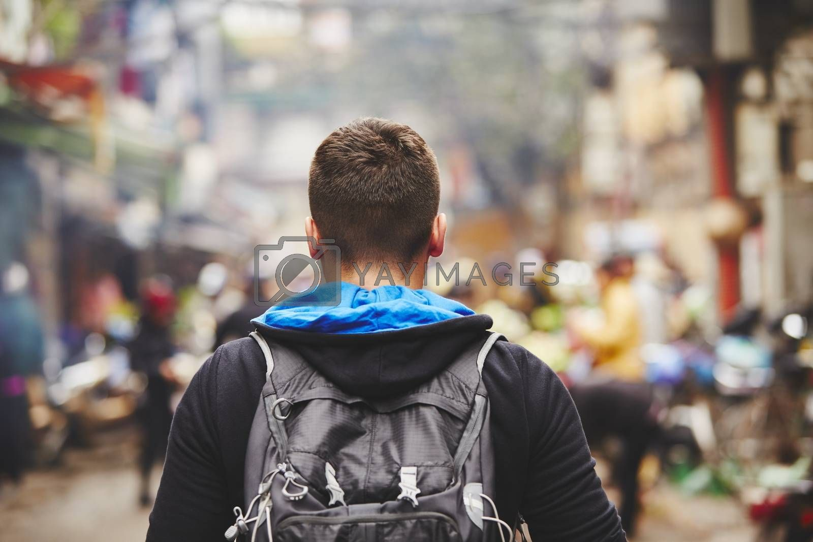 Young traveler with back pack - Hanoi, Vietnam