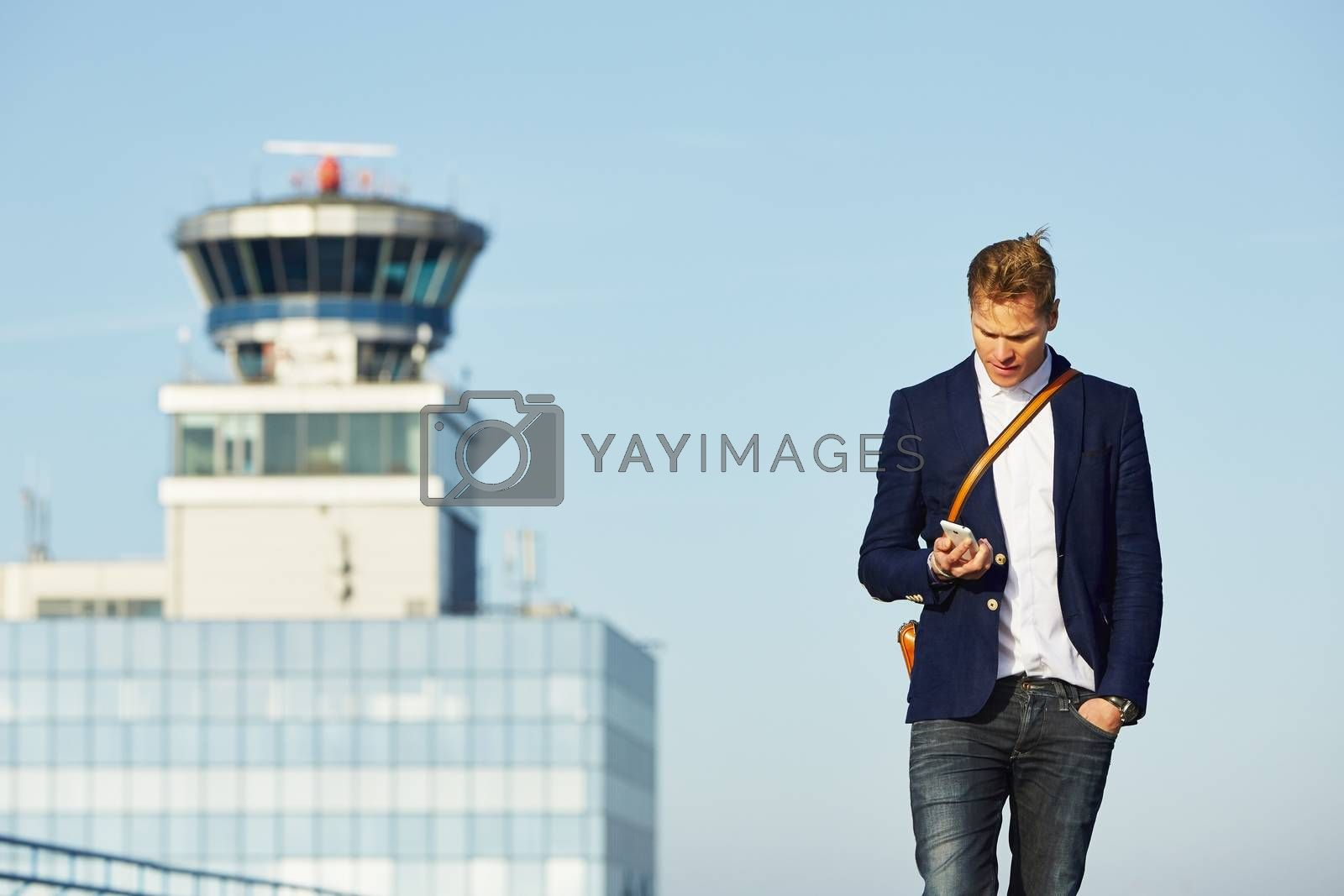 Handsome businessman is waiting at the airport
