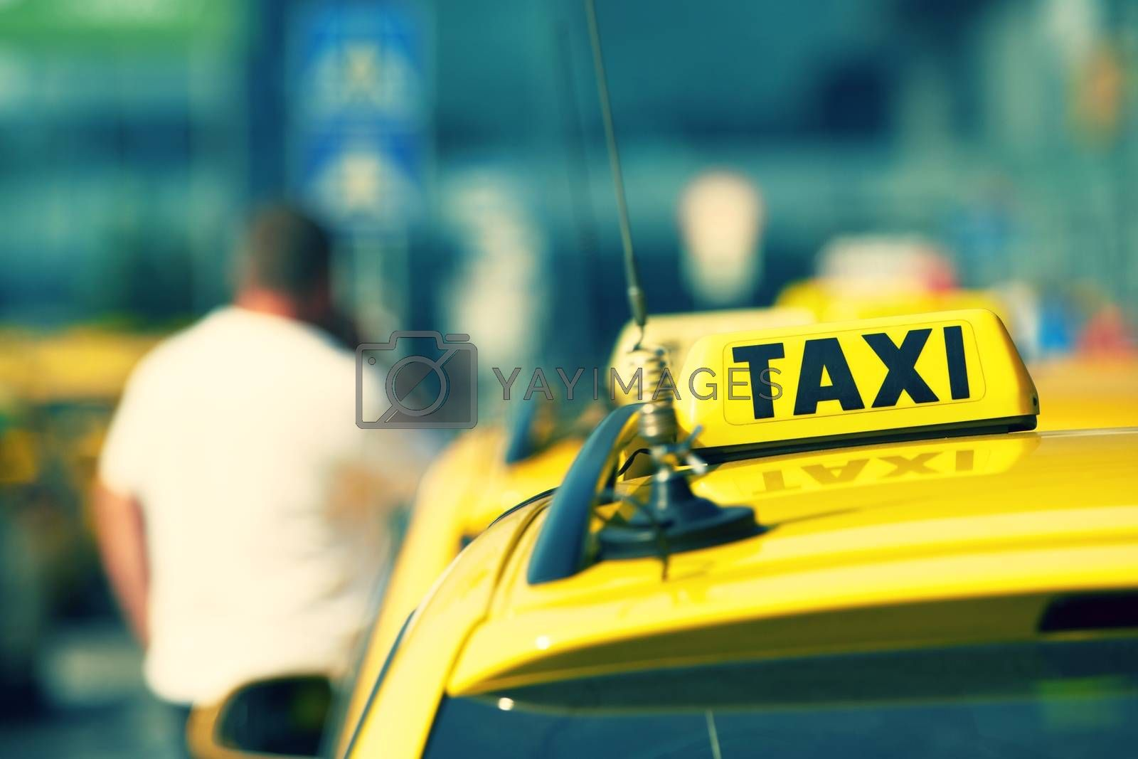 Taxi cars are waiting in row on the street - selective focus