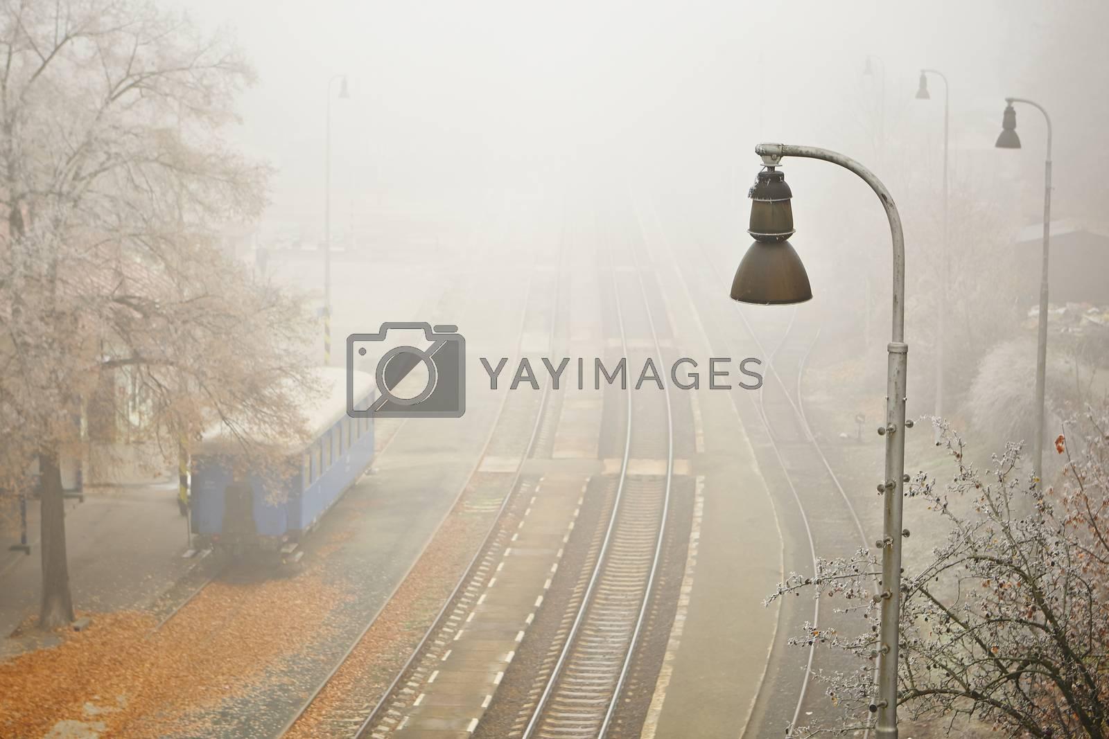 Old railway station in thick fog, Prague, Czech Republic