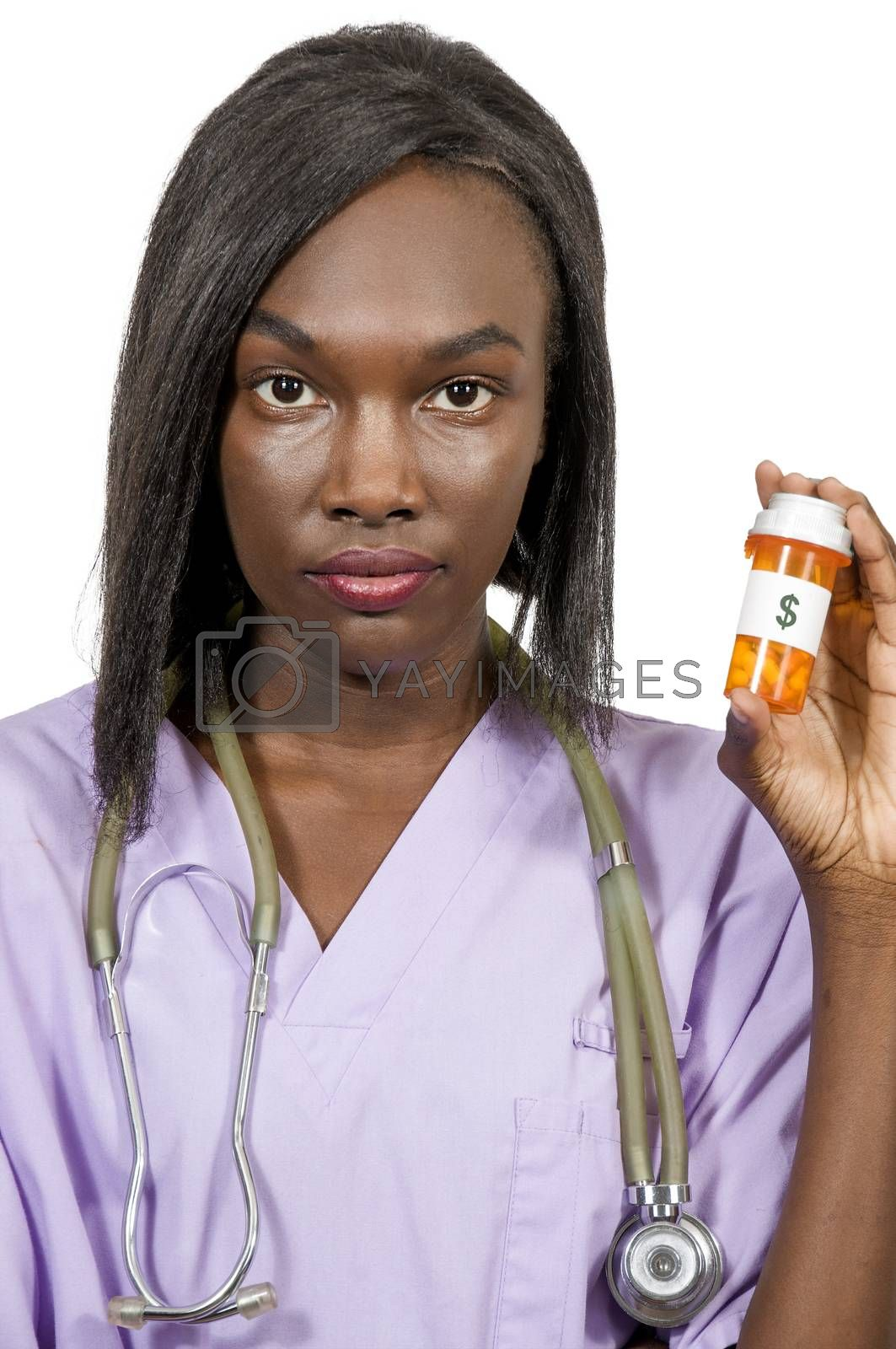 Beautiful young female doctor on her rounds holding a pill bottle of prescription medication
