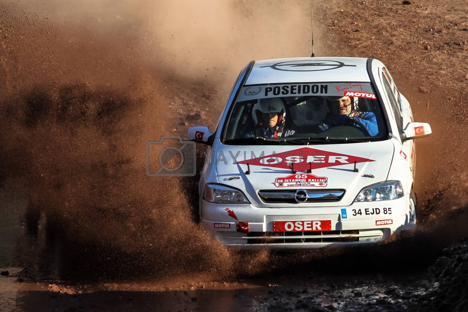 ISTANBUL, TURKEY - NOVEMBER 14, 2015: Osman Karaosman drives Opel Astra in Isok Istanbul Rally 2015, Gocbeyli stage