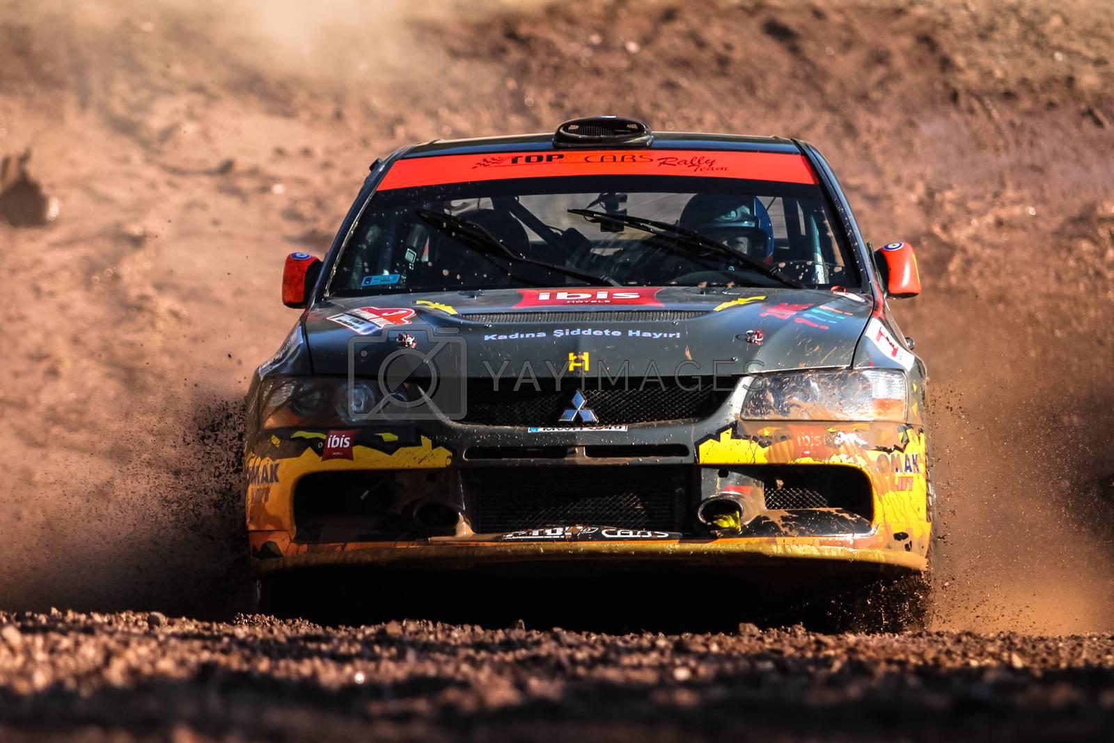 ISTANBUL, TURKEY - NOVEMBER 14, 2015: Burak Cukurova drives Mitsubishi Lancer Evo IX in Isok Istanbul Rally 2015, Gocbeyli stage