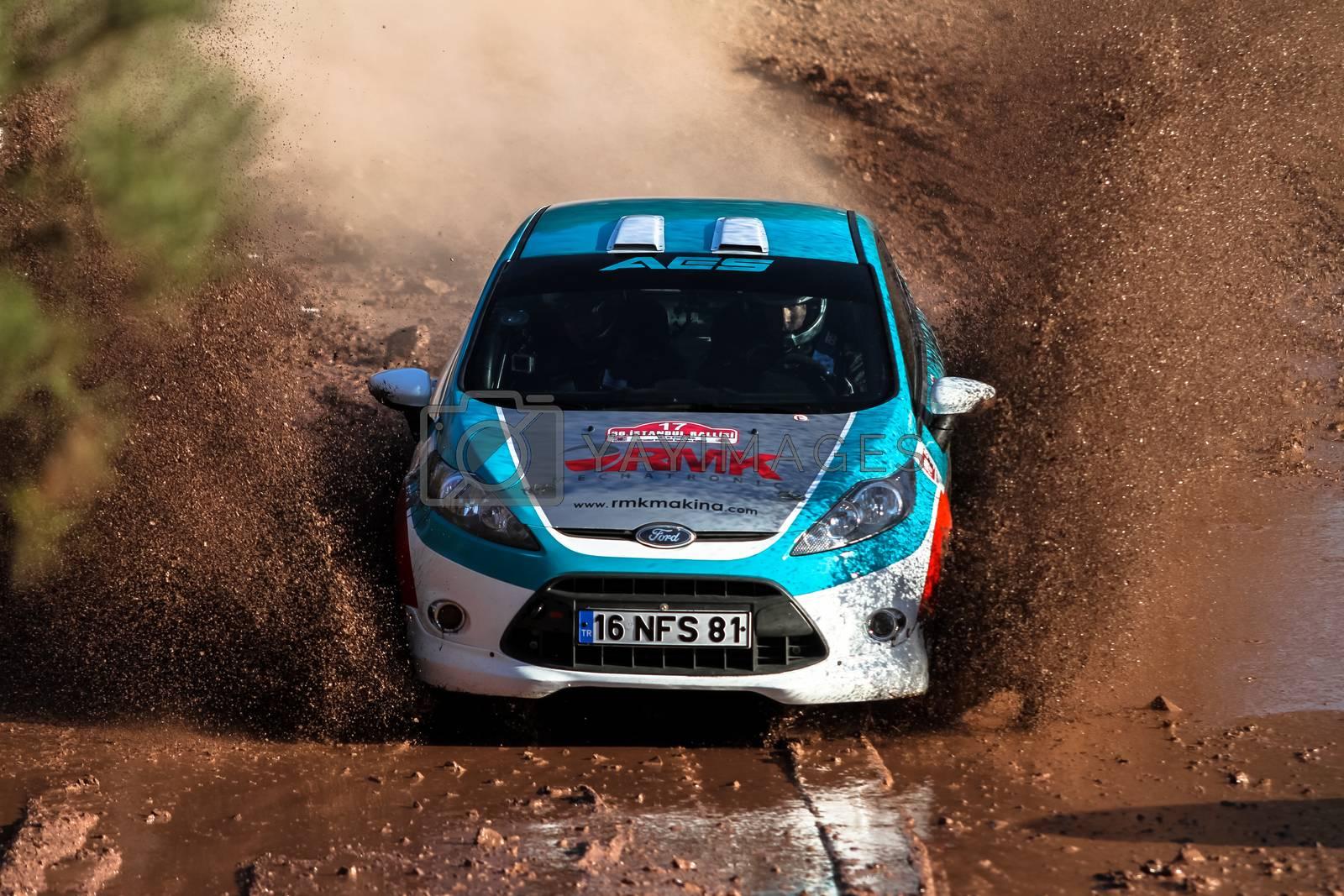 ISTANBUL, TURKEY - NOVEMBER 14, 2015: Ismet Toktas drives Ford Fiesta R2 in Isok Istanbul Rally 2015, Gocbeyli stage