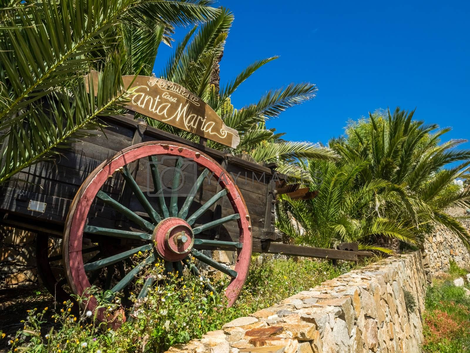 Old Cart Wheel in front of a restaurant in Betancuria, an old capital of Fuerteventura, Canary islands, Spain. Picture taken 13 April 2016