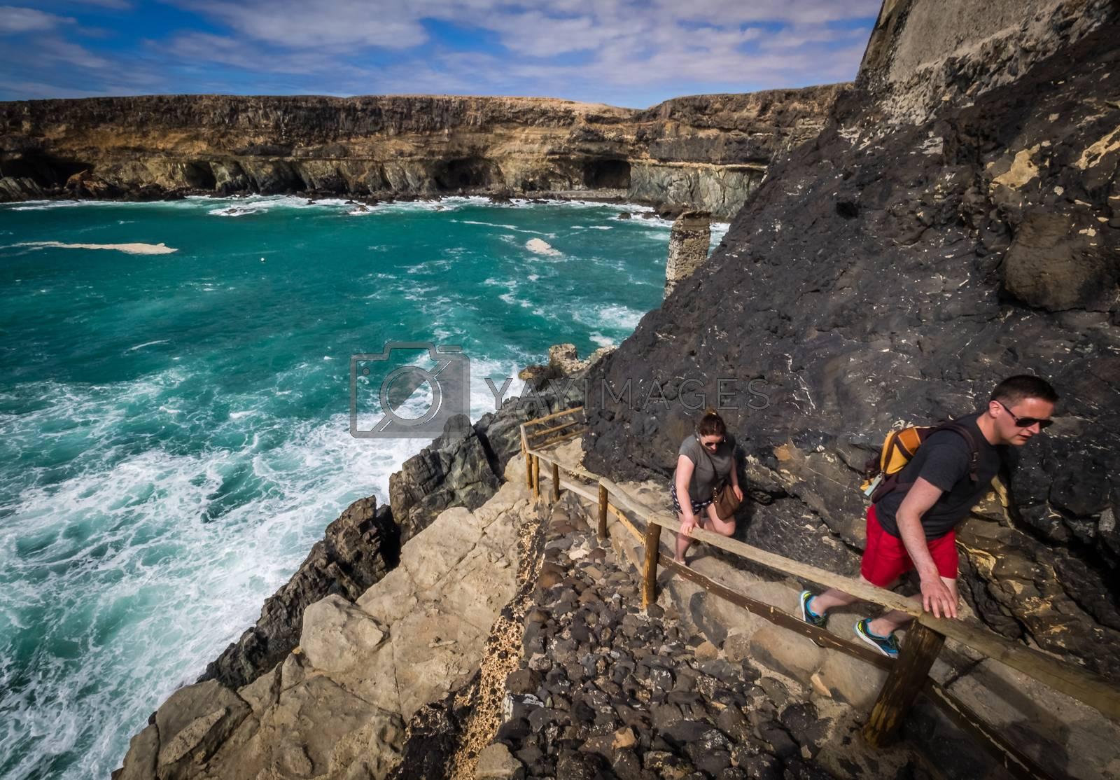 Tourists trekking along the coastline in Ajuy, Parque Rural de Betancuria in Fuerteventura, Canary Island, Spain. Picture taken 13 April 2016