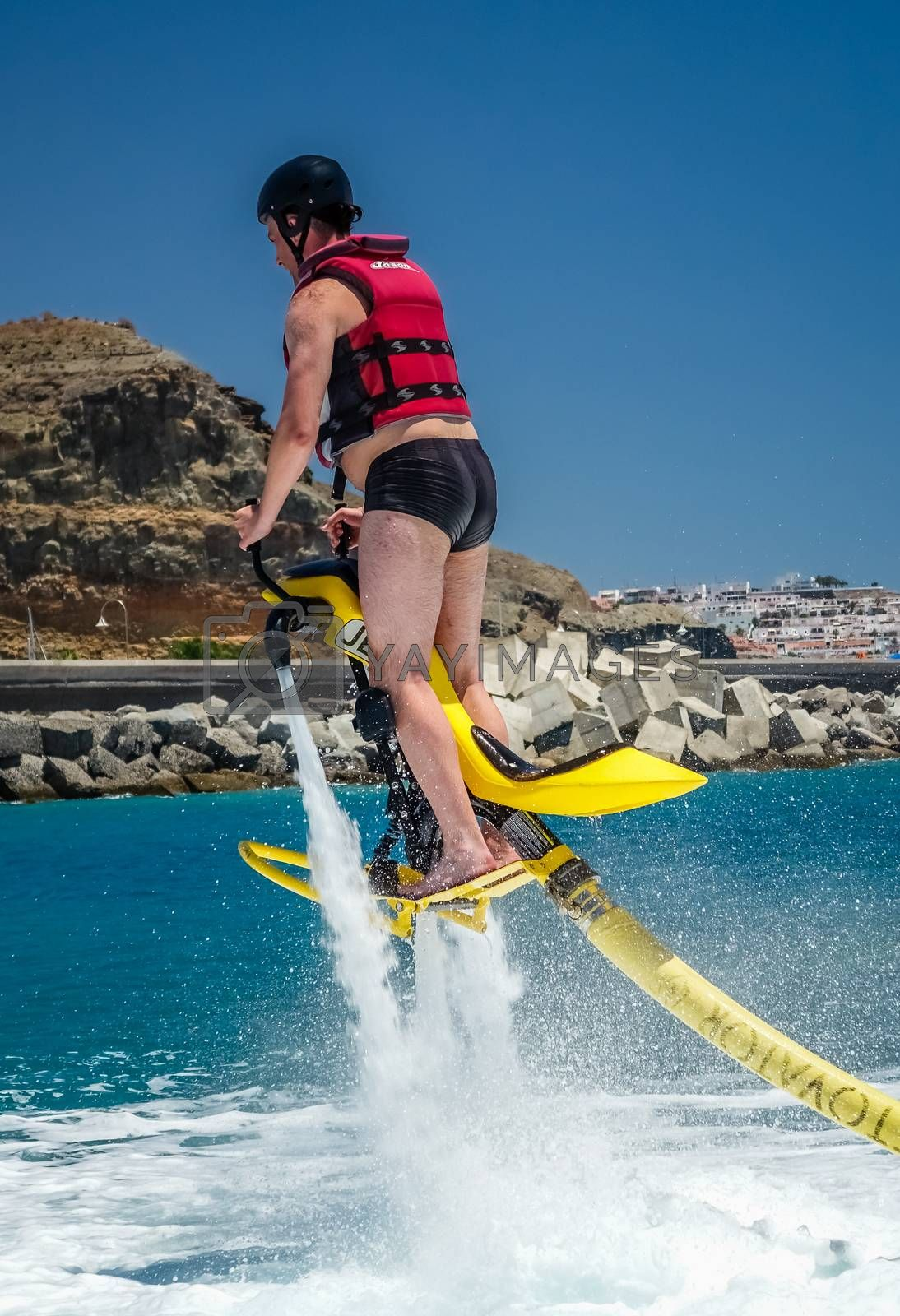Royalty free image of MAn on jet ski hover by pawopa3336