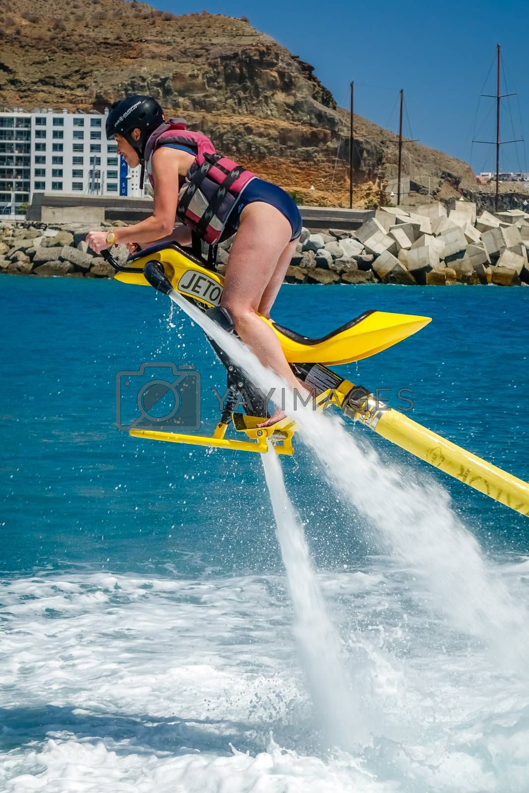 Royalty free image of Woman on a jet ski by pawopa3336