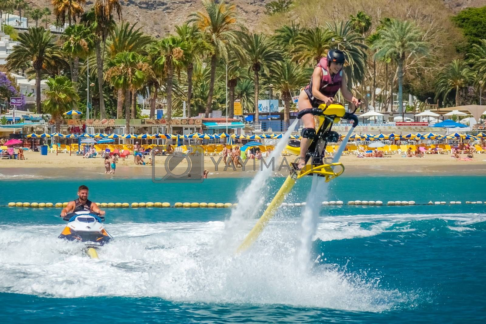 Woman hovering above water on a jet ski in Gran Canaria, Spain. Picture taken on the 8th May 2015.