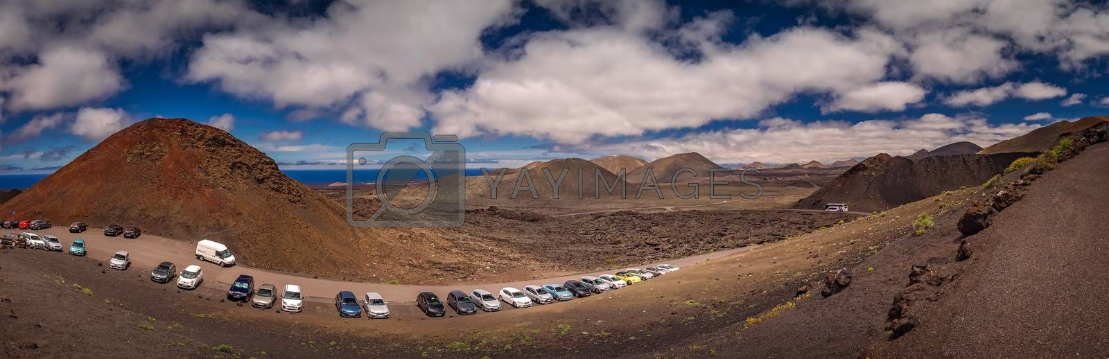 Car parked at the entrance to the Timanfaya National Park ( also called The Montanas del Fuego or Mountains of Fire ) in Lanzarote, Canary Islands, Spain. Picture taken 23 April 2016. April 2016.