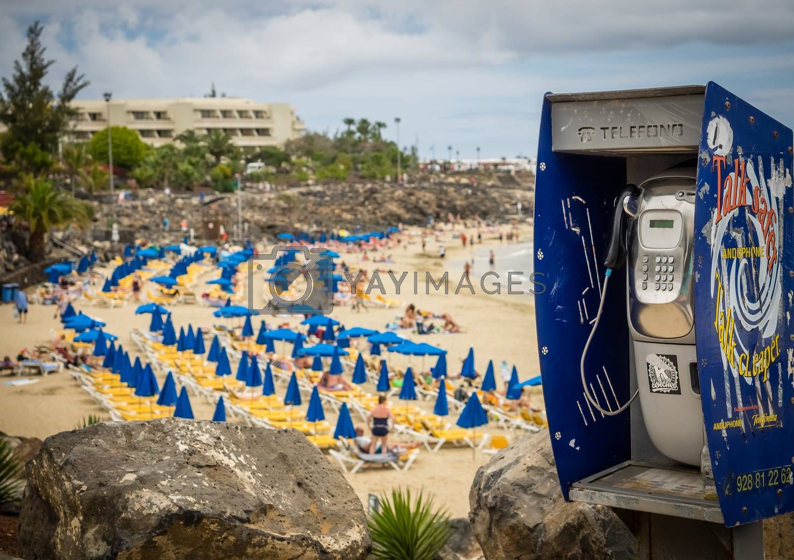 Public phone on the promenade above the puclic beach in Playa Blanca in Lanzarote, Canary Islands, Spain. Picture taken 18 April 2016