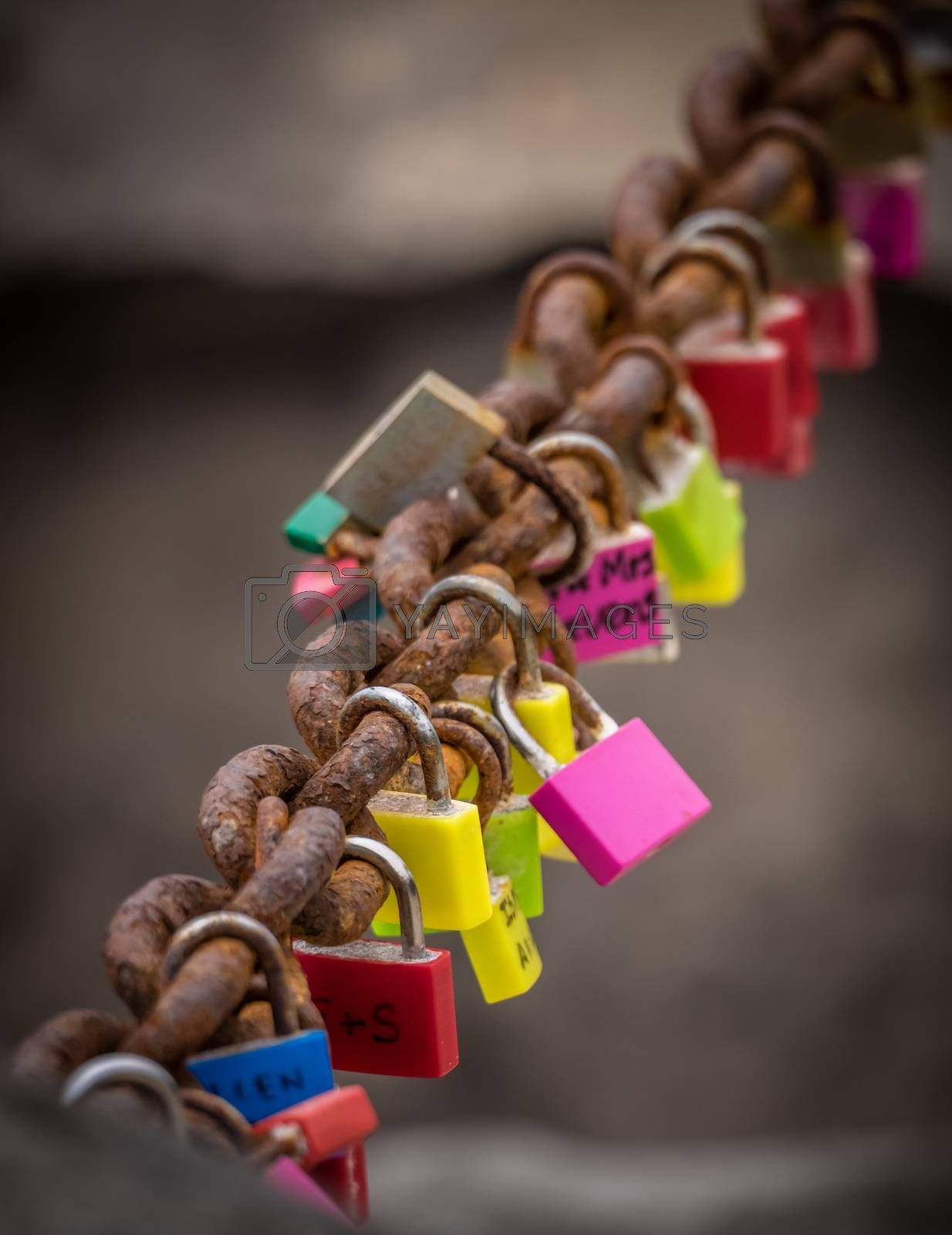 Padlocks with lovers names and initials attached to a chain on the promenade in Playa Blanca, Lanzarote, Canary Islands, Spain. Picture taken 18 April 2016