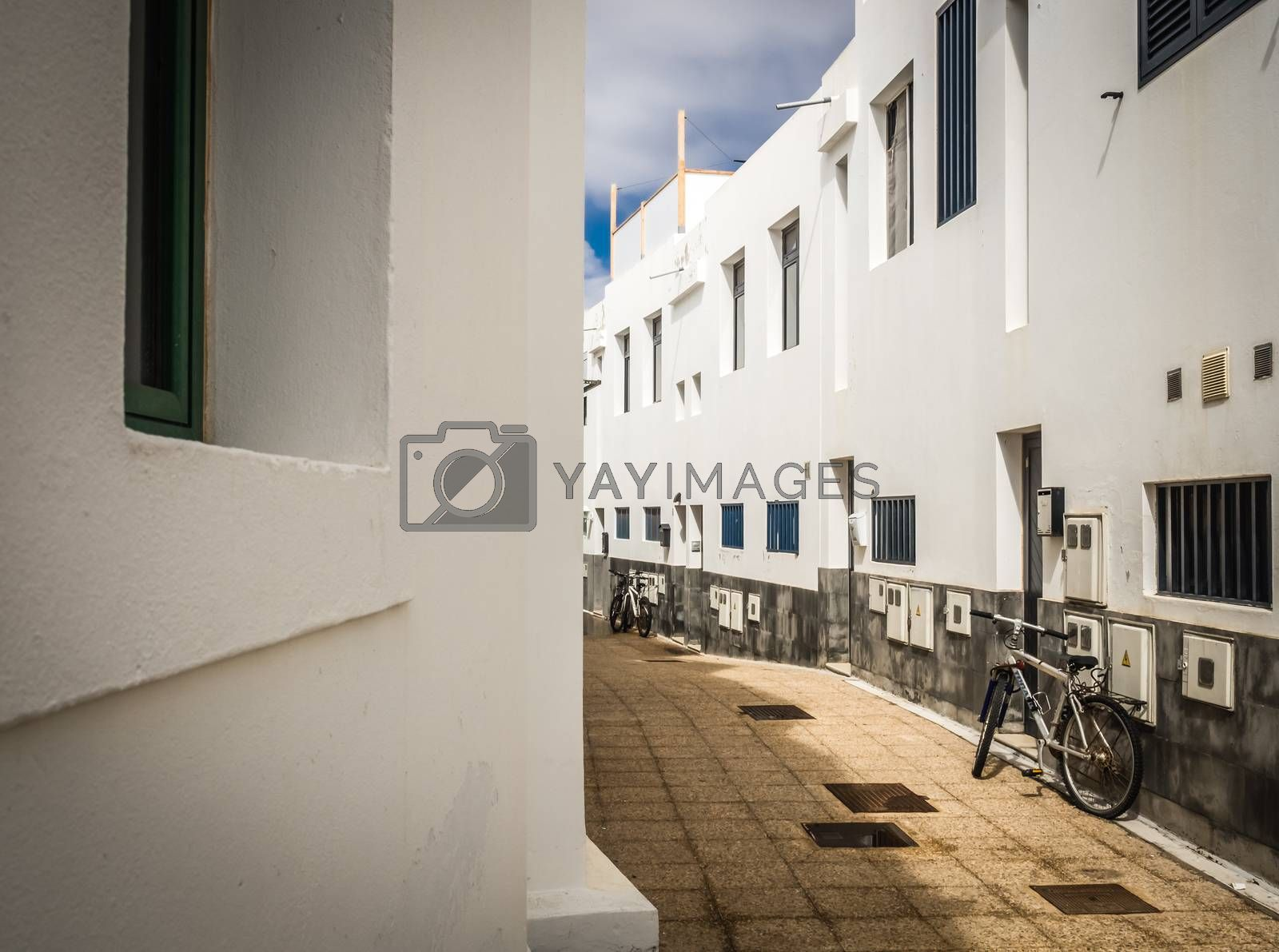 Bicycles parked in a narrow street in Playa Blanca, Lanzarote, Canary Islands, Spain. Picture taken 19 April 2016