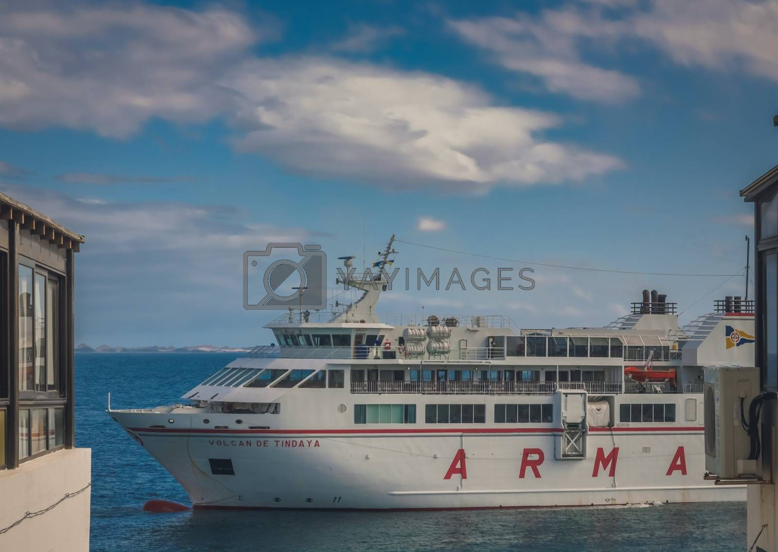 Large passenger ferry Armas docked in a harbour in Playa Blanca, Lanzarote, Canary Islands, Spain. Picture taken 19 April 2016
