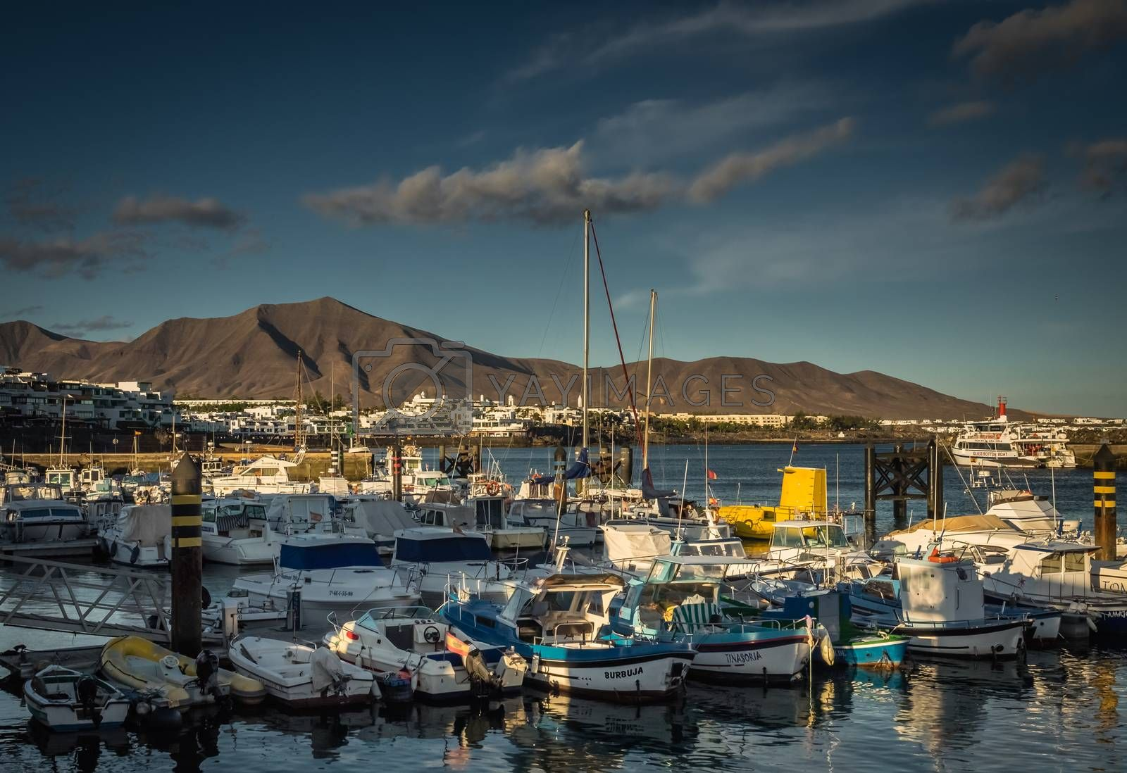 Colorful boats in a harbour in Playa Blanca, Lanzarote, Canary Islands, Spain. Picture taken 22 April 2016