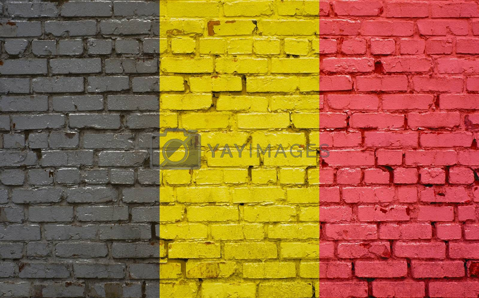 Flag of Belgium painted on brick wall, background texture