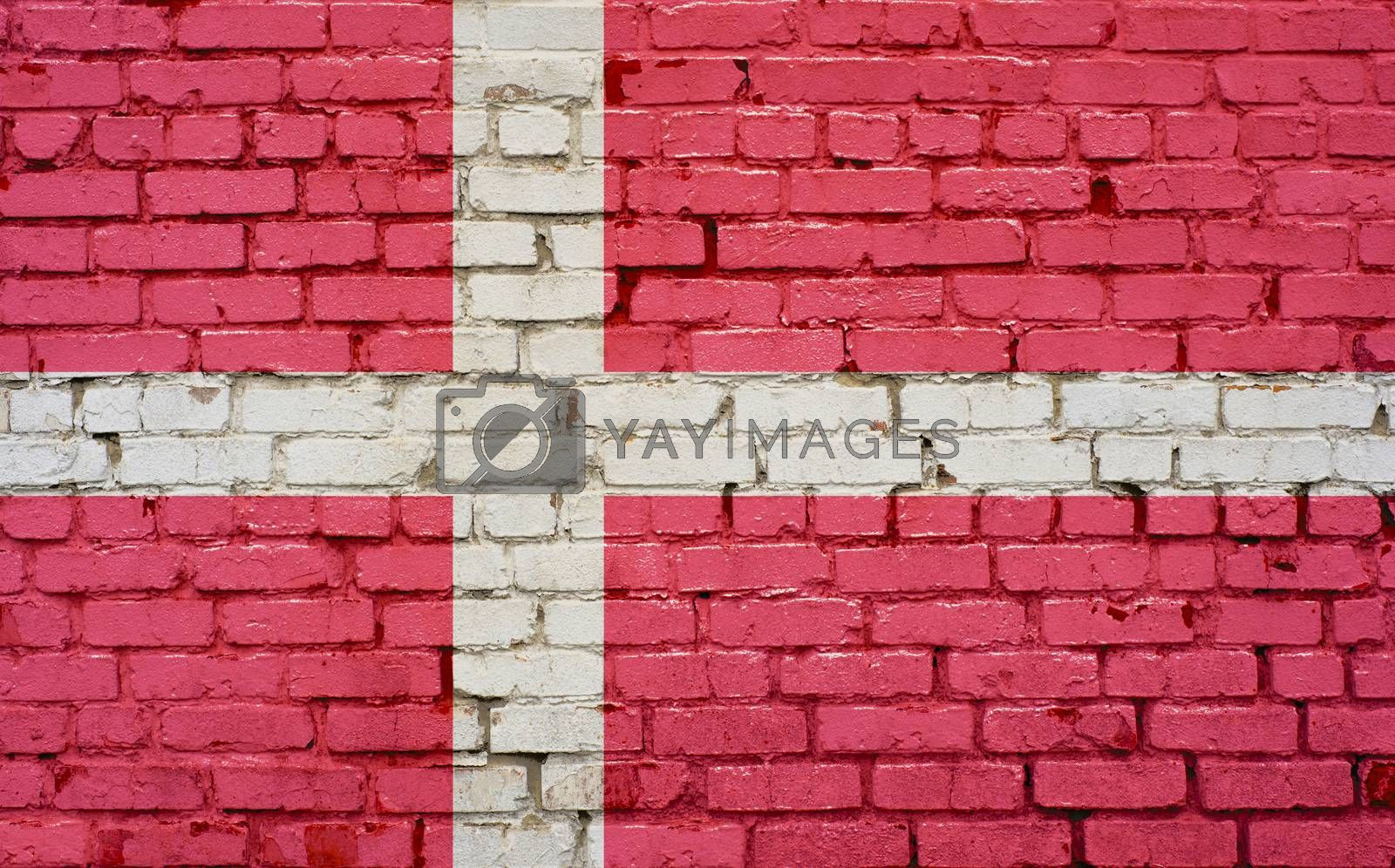 Flag of Denmark painted on brick wall, background texture