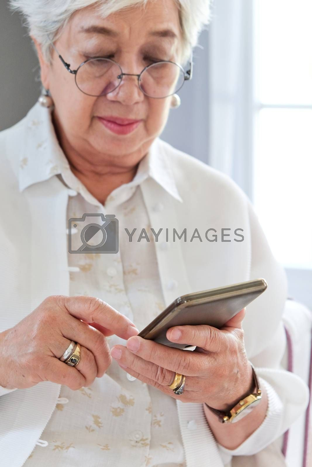 Senior woman using her mobile phone.