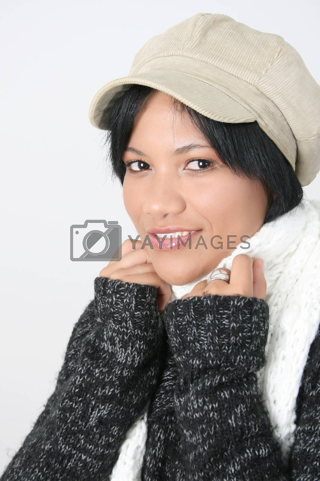 Young brunette female wearing a hat with scarf wrapped around her