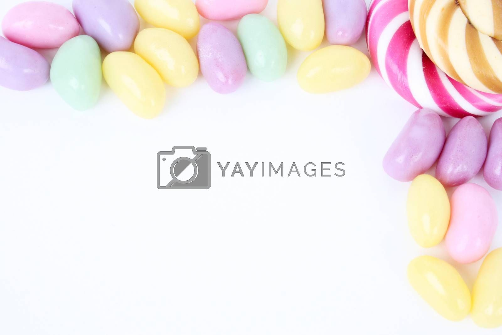 Multi coloured candies on a white background