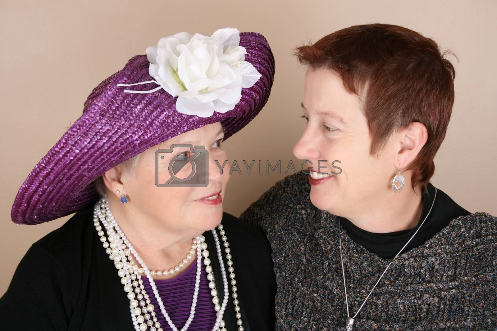 Beautiful mother and daughter in a studio setting