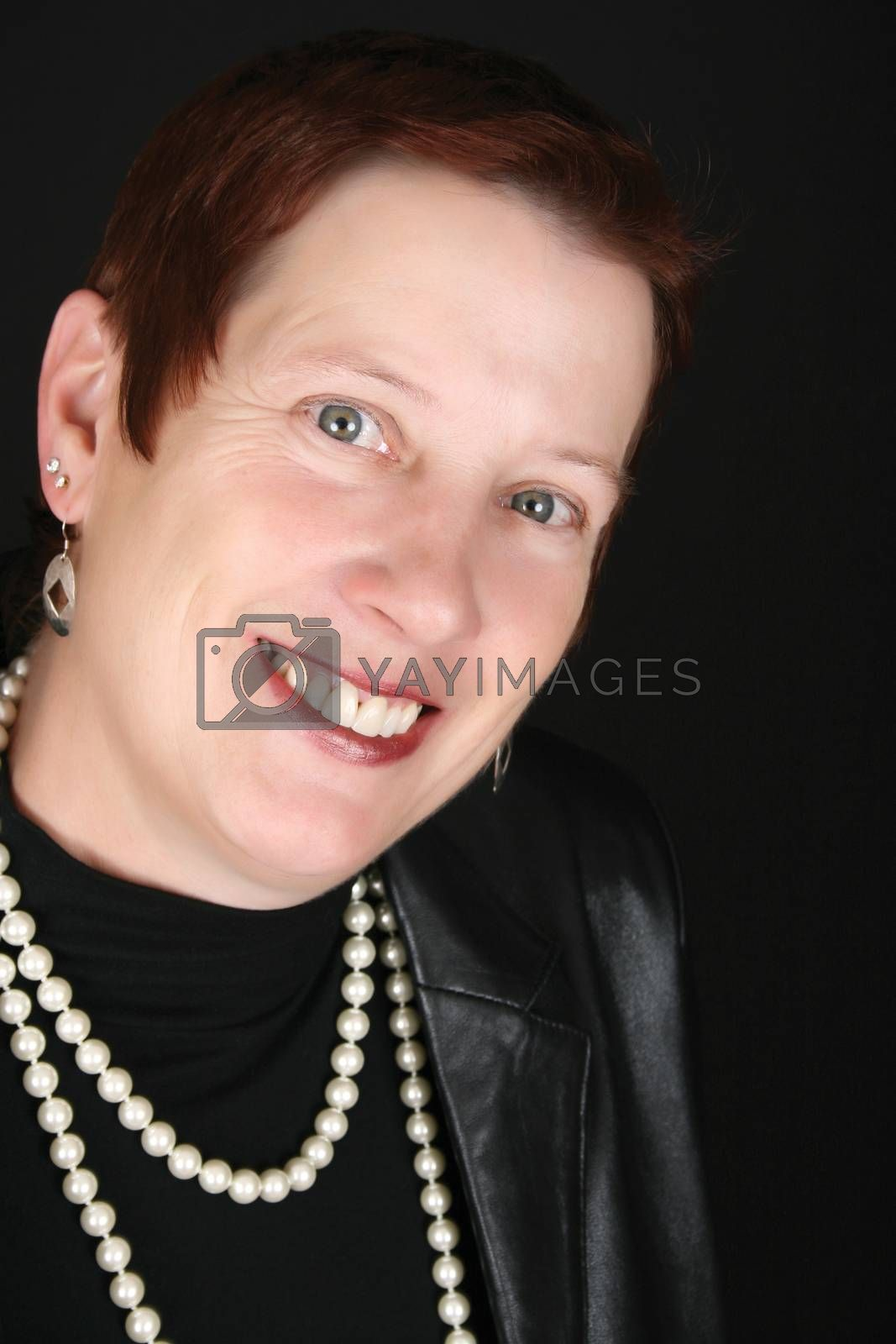 Elegant female wearing a black leather jacket and pearls