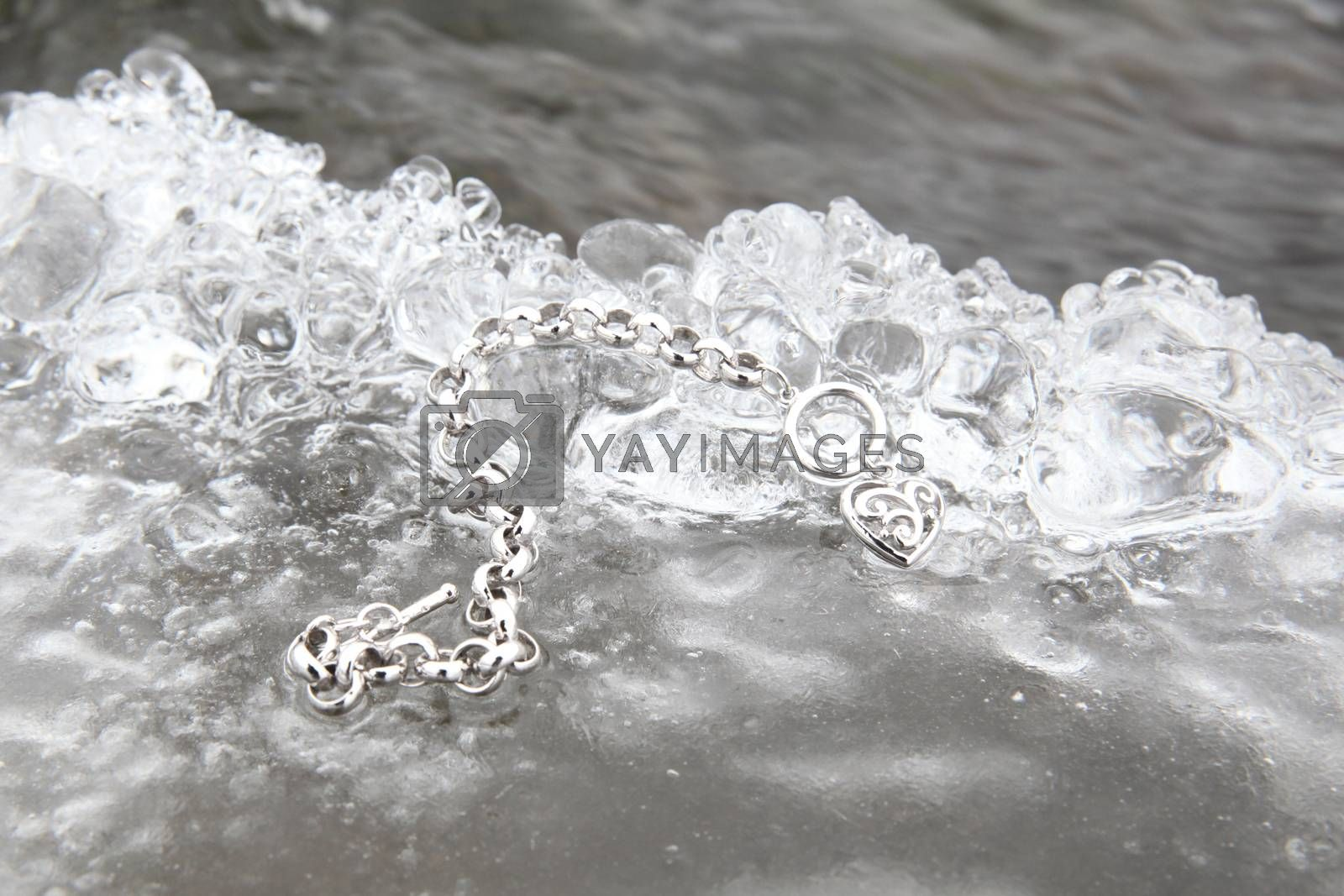 Layer of ice with a heart shaped bracelet charm