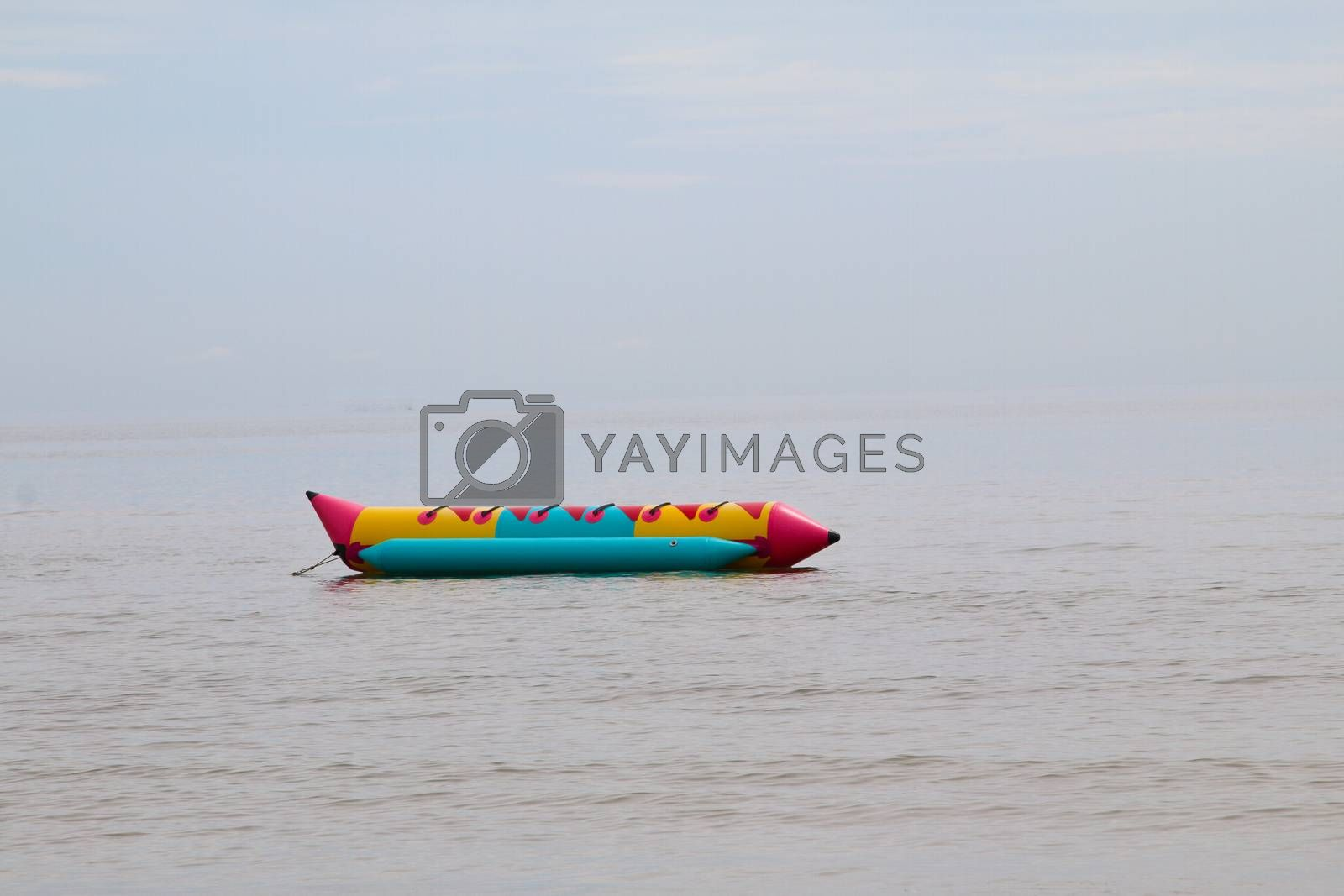 colorful banana boat floating on the water sea