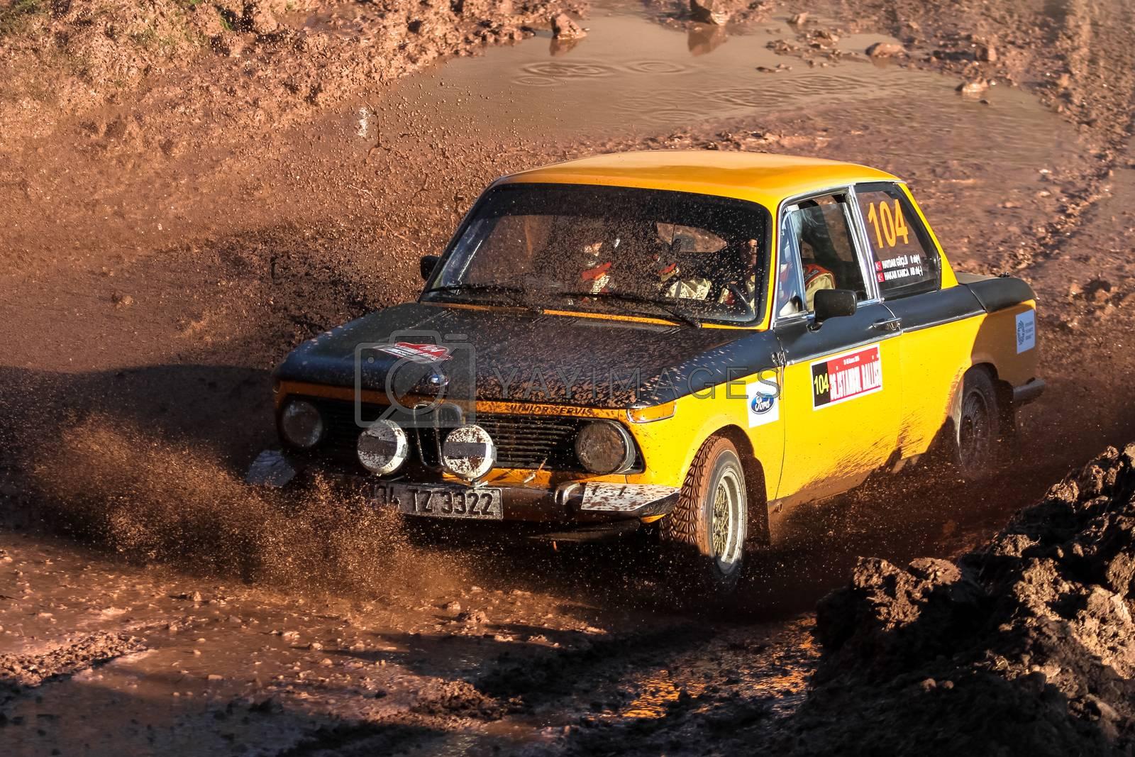 ISTANBUL, TURKEY - NOVEMBER 14, 2015: Haydar Guclu drives BMW 2002 TI in Isok Istanbul Rally 2015, Gocbeyli stage