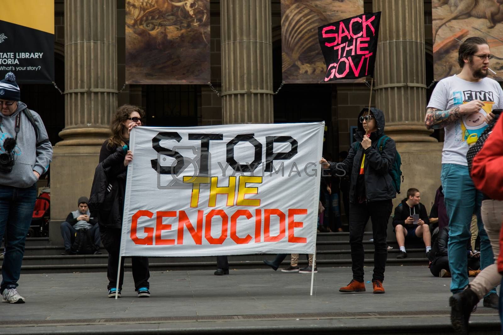 Protesters rally against the torture and detention of indigenous children in the Northern Territory. The rally was held outside the State Library.