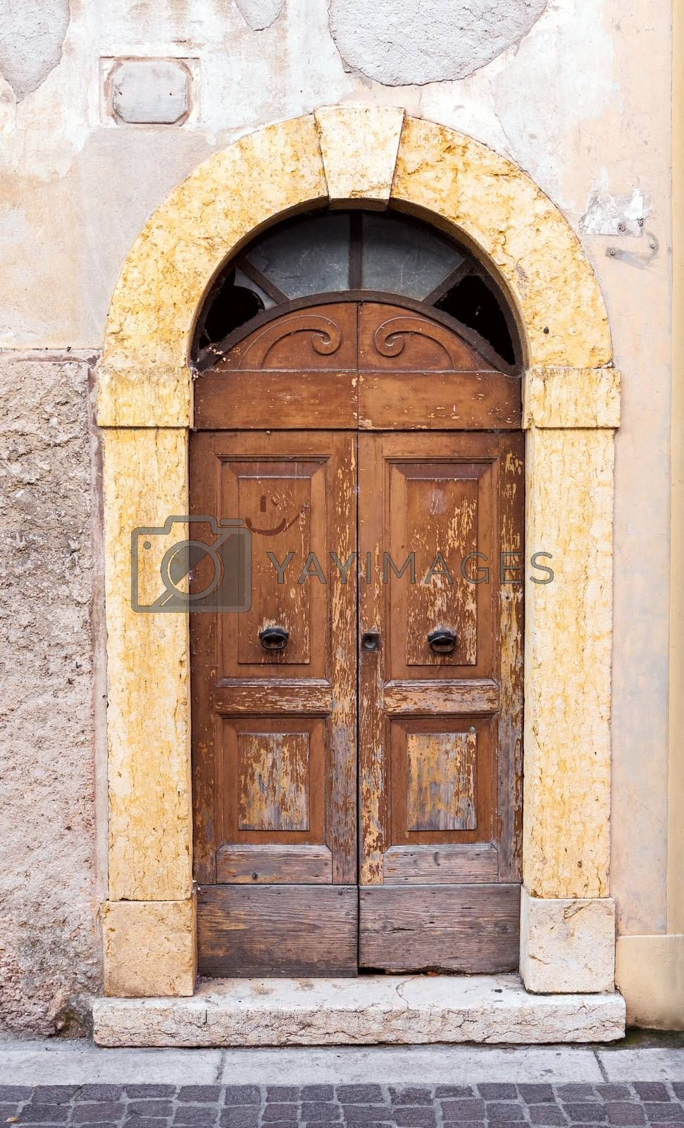Old weathered wooden doors in Italy