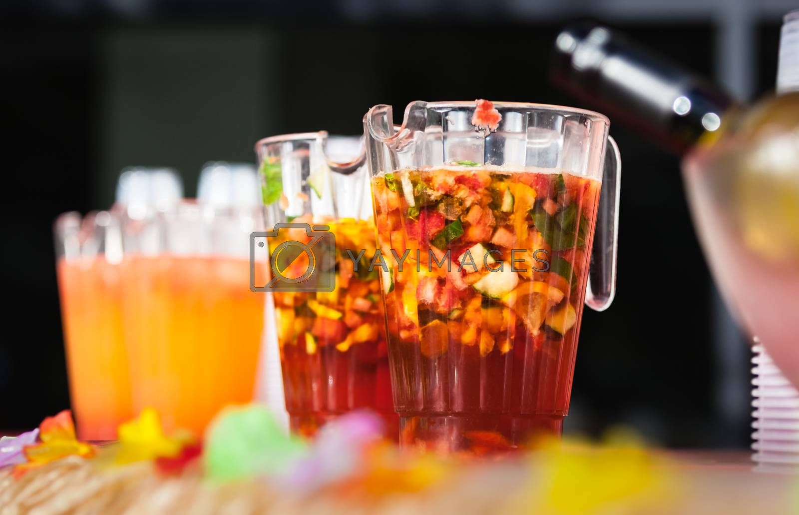 Jugs containing alcoholic fresh fruit punch to be served for guests