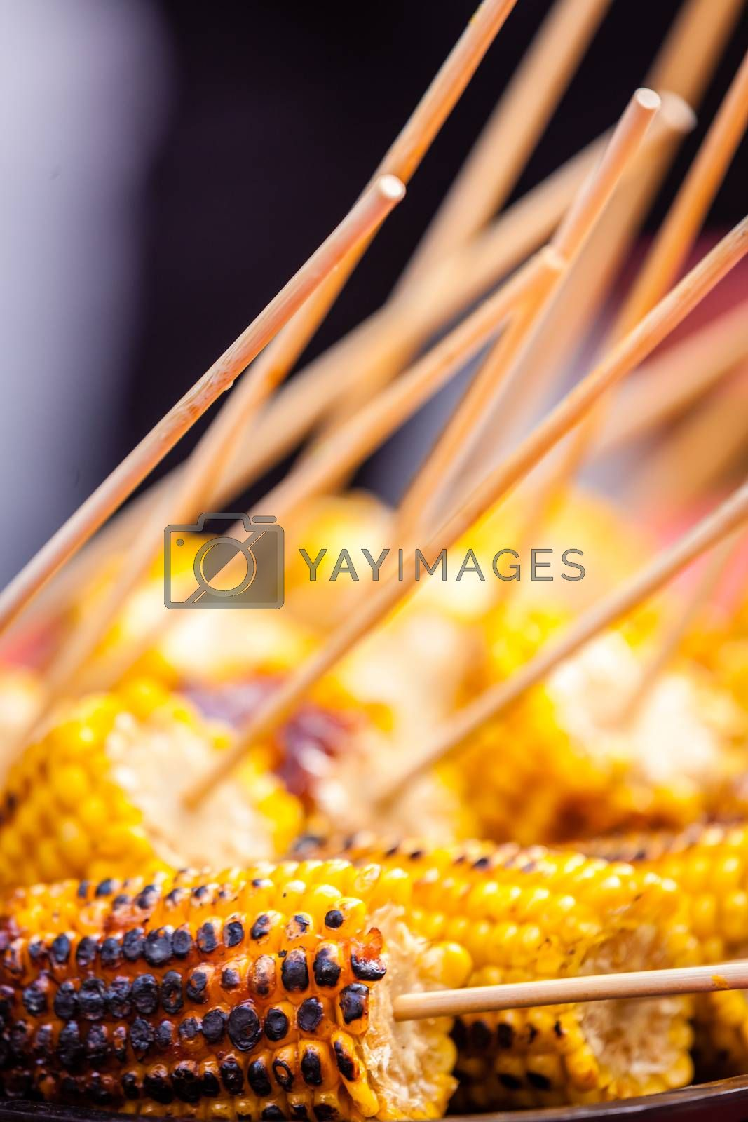 Fresh corn grilled during an outdoors barbecue