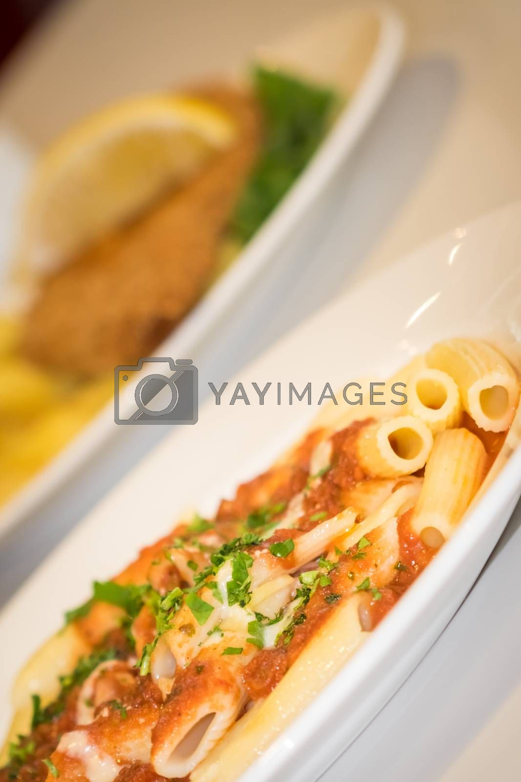 Close-up of freshly made pasta penne arabiata garnished with green parsley