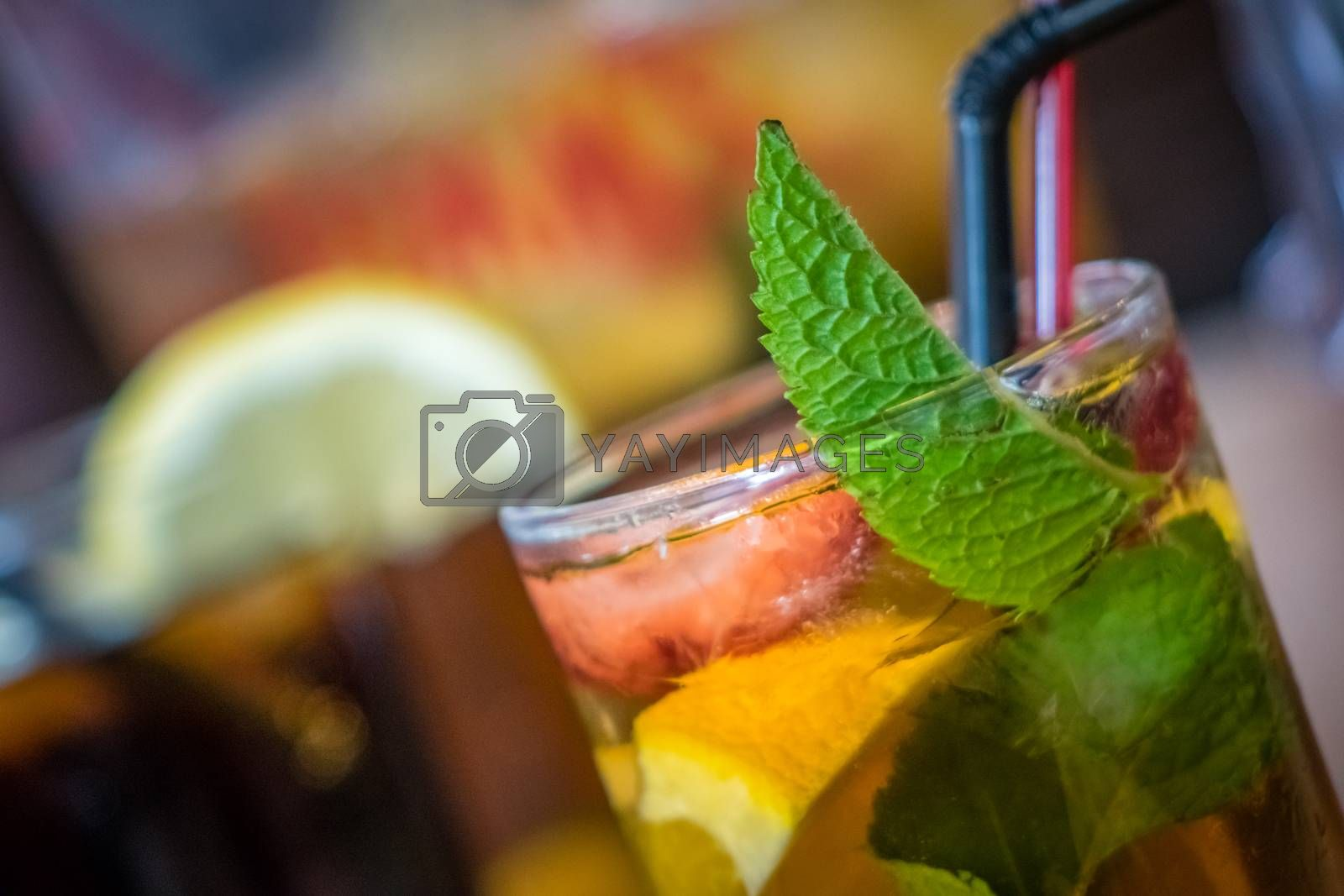 Glasses containing pimms drink and cola on a table in a pub