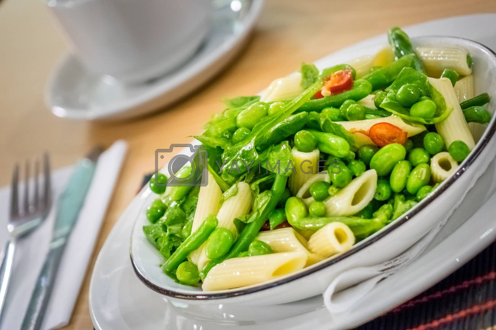 Close-up of freshly made green vegetables penne pasta