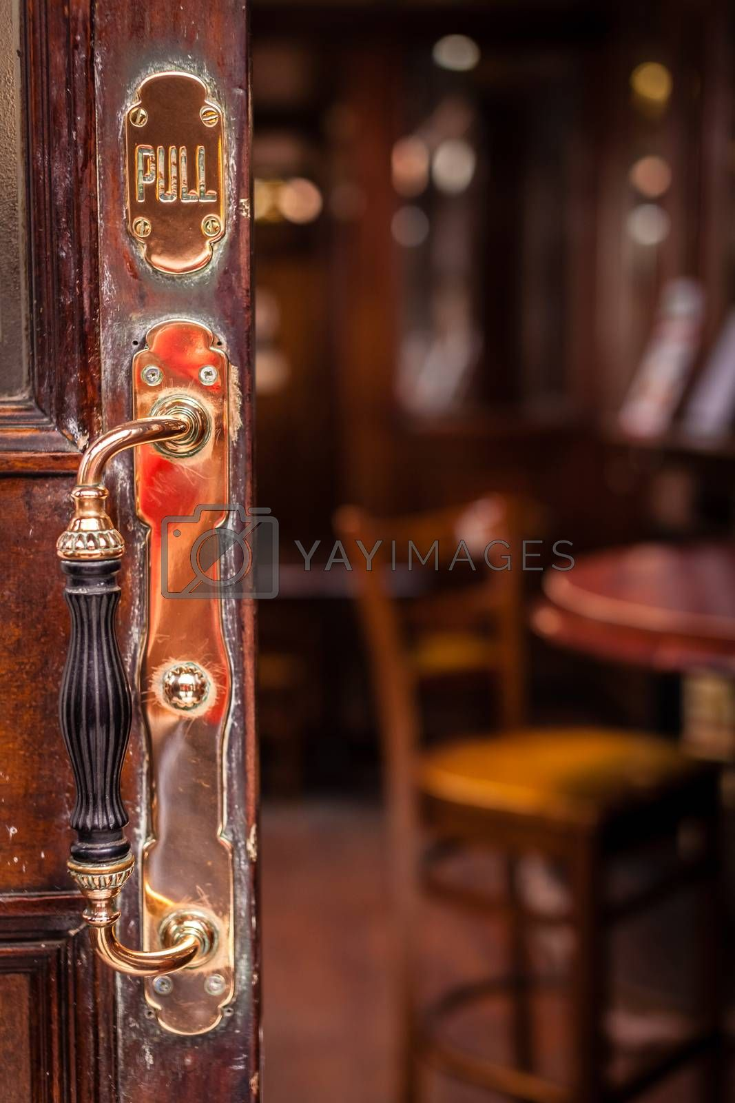 Door handle at the entrance to the traditional English pub in London, UK