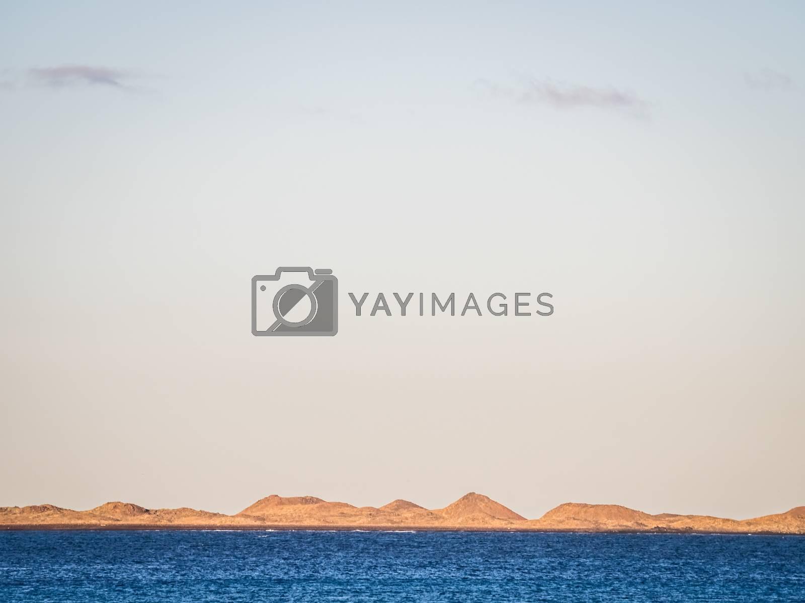 Blue sea in Corralejo Dunes National Park in Fuerteventura, Canary Island, Spain