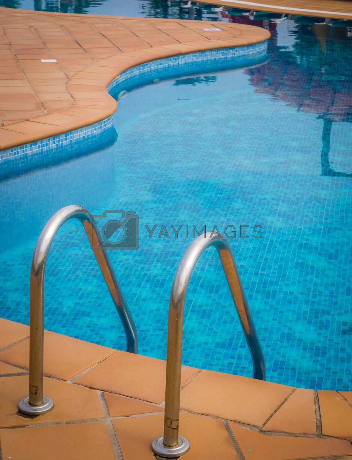Detail of swimming pool ladder in a holiday resort