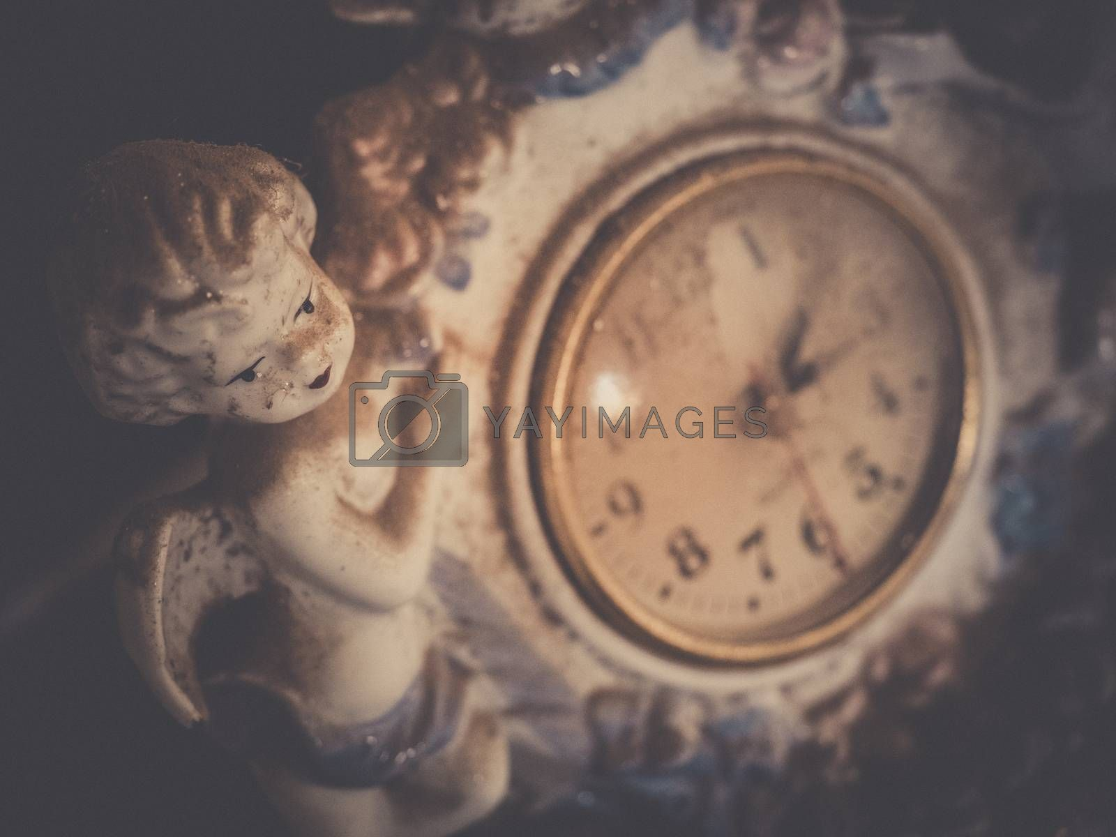 Old vintage porcelain watch with a angel figure attached