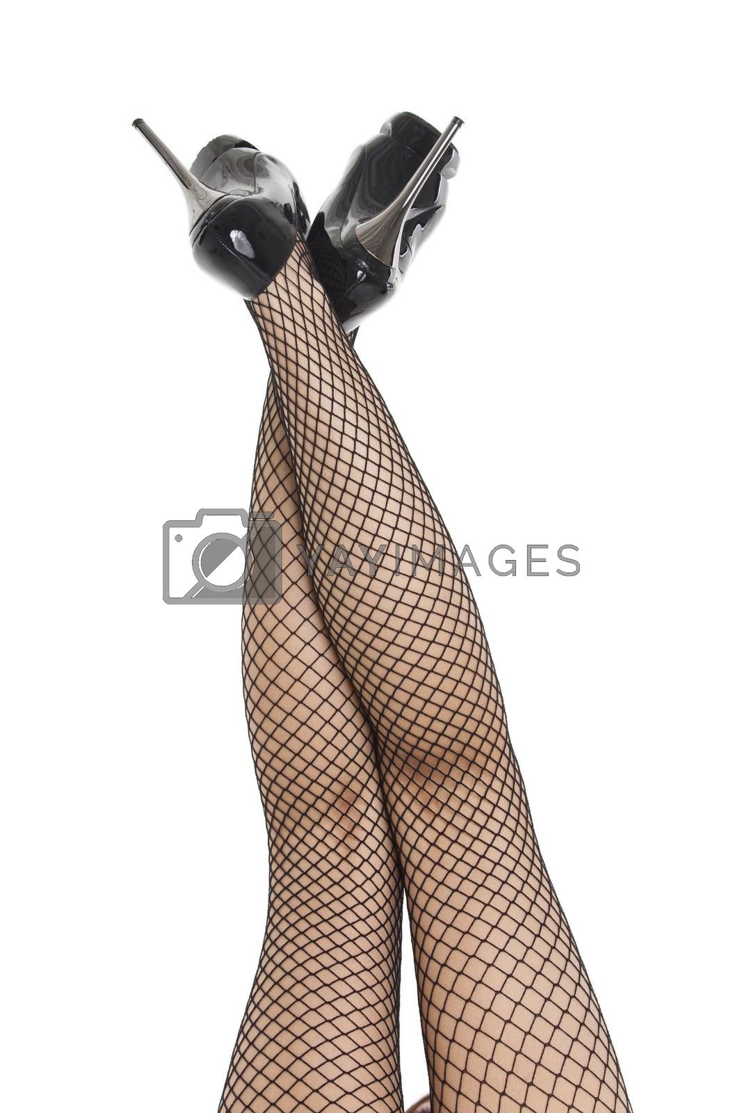 womans feet in fish net stockings