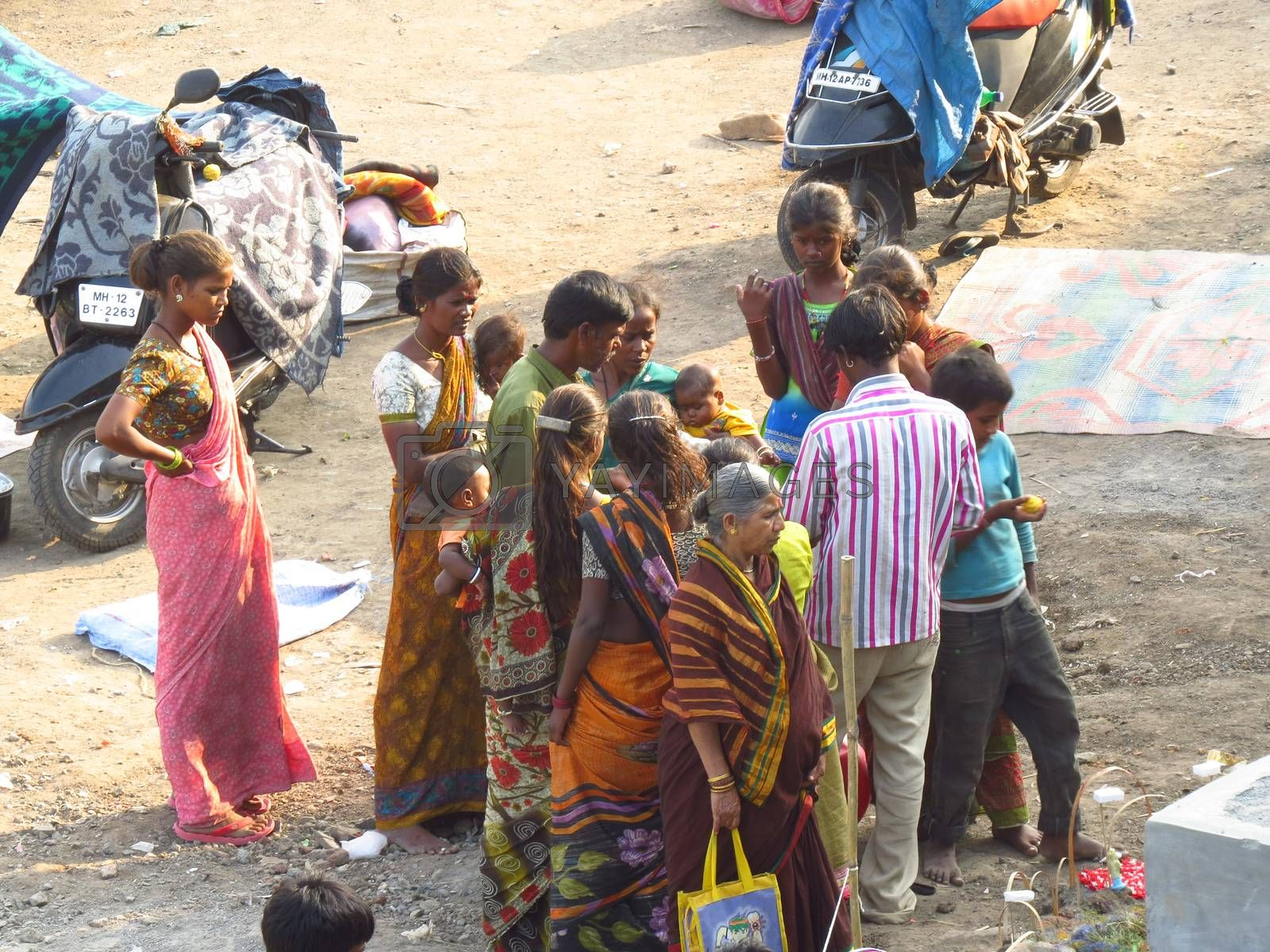 Royalty free image of A family of poor people in India discussing their problems by thefinalmiracle