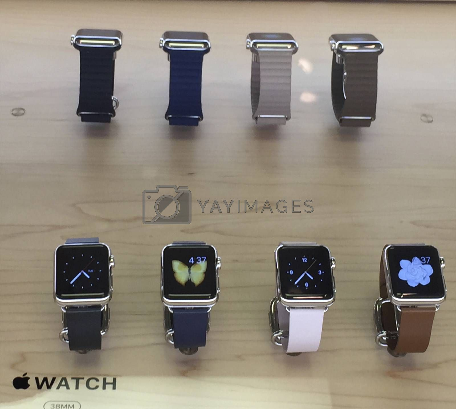 Apple watch displayed in Apple Store, USA.   NEW YORK,  UNITED STATES AMERICA - APR 25 2015: New Apple Watch smartwatch displaying inside a glass cabinet, New York, USA