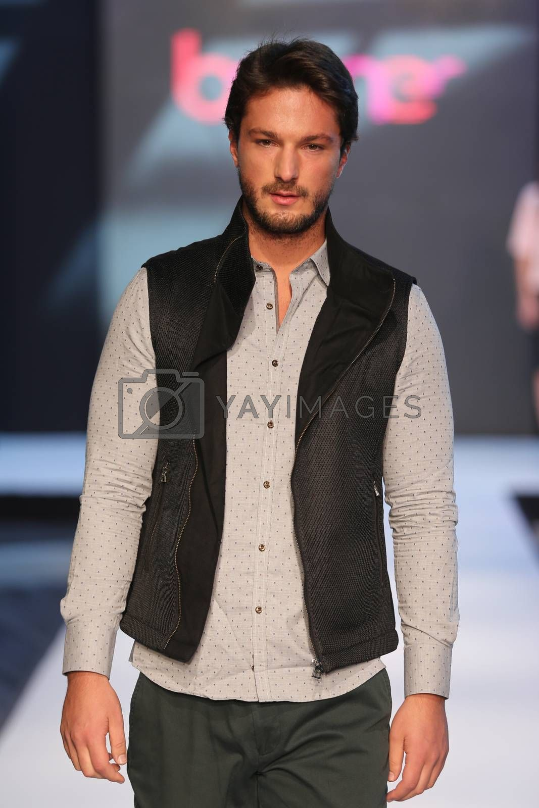 ISTANBUL, TURKEY - OCTOBER 10, 2015: A model showcases one of the latest creations of Boyner in Forum Fashion Week
