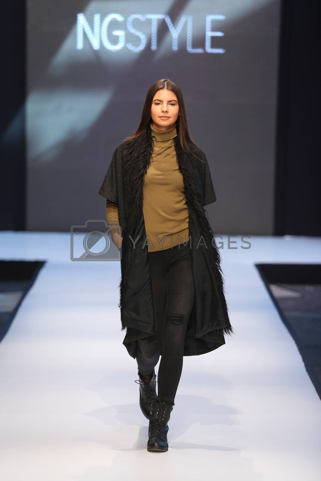 ISTANBUL, TURKEY - OCTOBER 10, 2015: A model showcases one of the latest creations of NGStyle in Forum Fashion Week