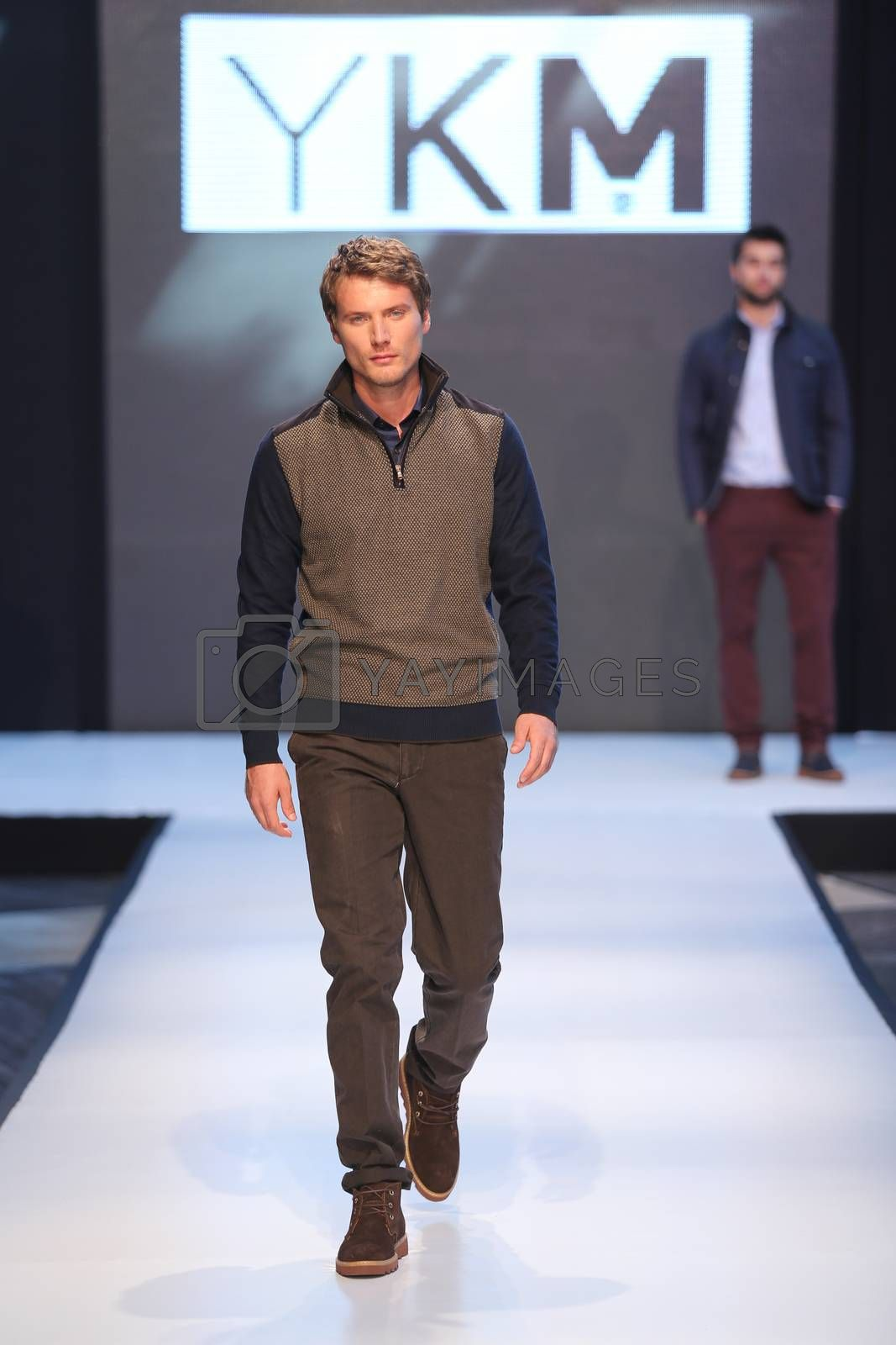 ISTANBUL, TURKEY - OCTOBER 10, 2015: A model showcases one of the latest creations of YKM in Forum Fashion Week
