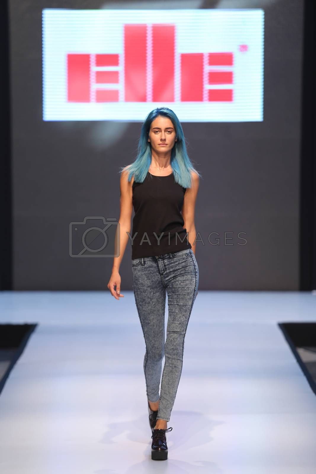 ISTANBUL, TURKEY - OCTOBER 10, 2015: A model showcases one of the latest creations of Elle in Forum Fashion Week